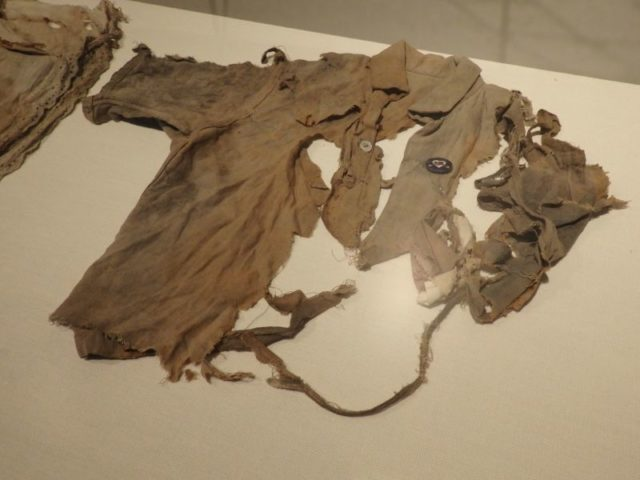 This shirt, worn by one of the student victims of the Hiroshima bomb, is torn and charred.